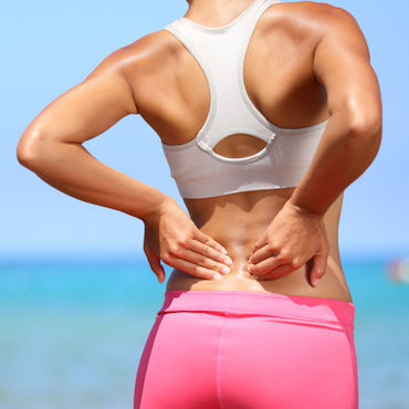 Woman holding her lower back